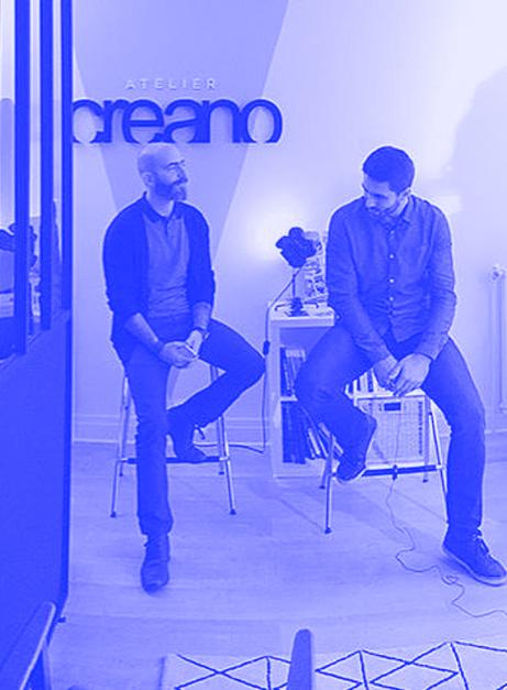 Photo de Matthieu et de son co-fondateur dans son agence Creano